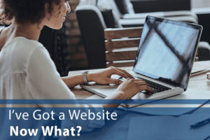 "Woman at Computer with word ""I've Got a Website, Now What?"